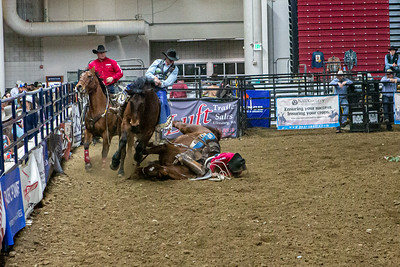 Ricky Shannon's horse gets tangled up with BiG Easy of Corey and Lange Rodeo after Trenton Montero rides for 83.oo in the first round of CRC Finals