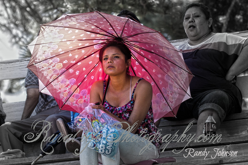 When shooting Rodeos Iam always looking out side the arena for interesting shots and things that catch my eye, and this young lady with the sun shining through her pink umbrella did just that (Had to take this shot )