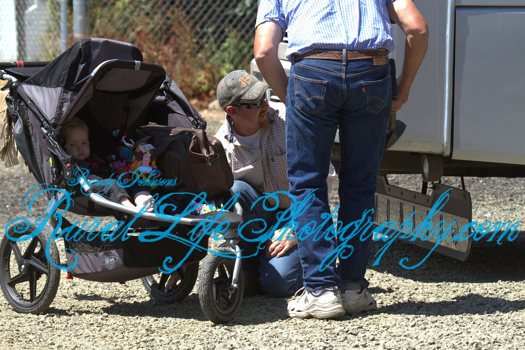 Mom is Riding as returning  Royalty, while Dad is putting air in the stroller tire,Team work..