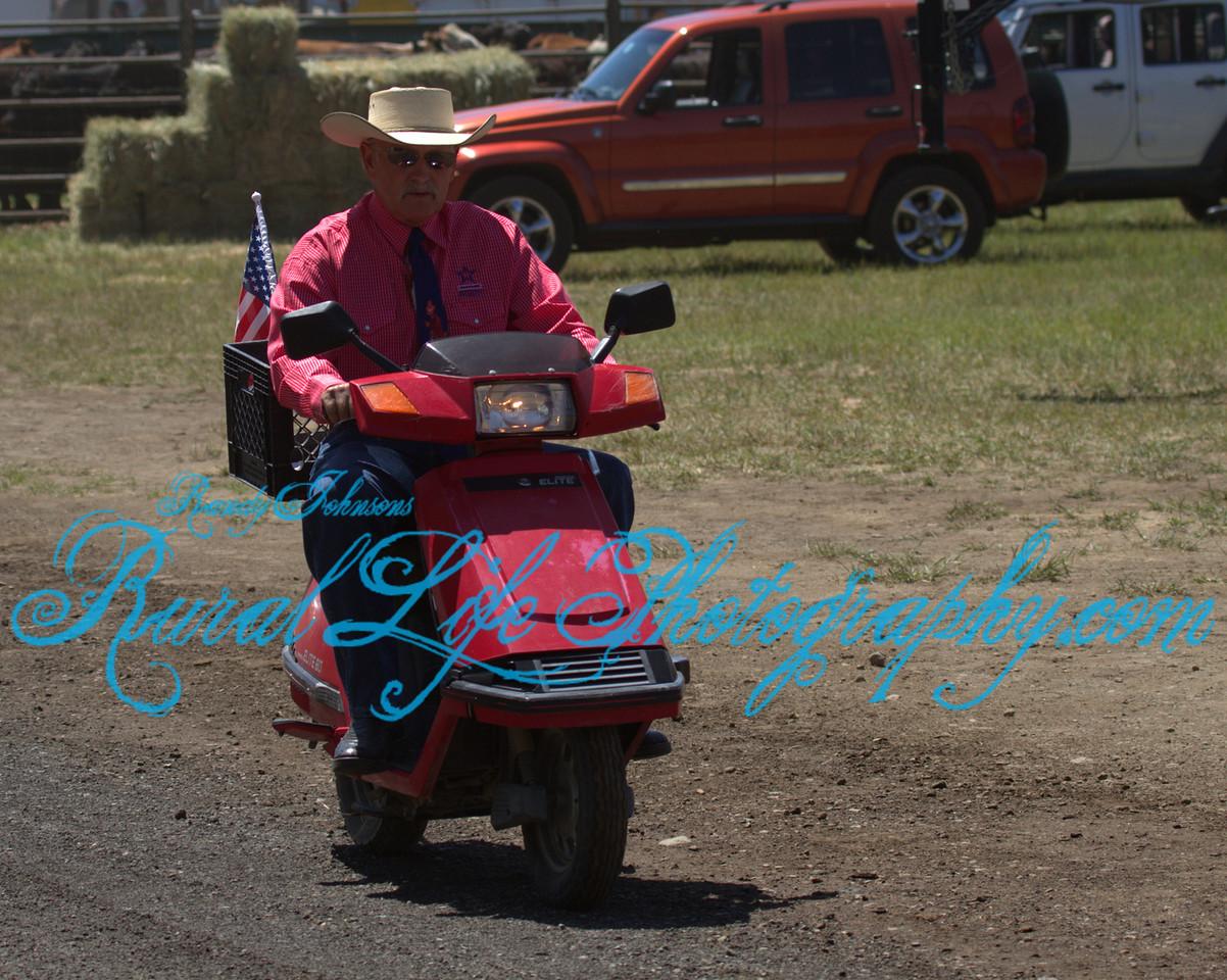 Announcer Bob Garrett rolling in on 2 wheels
