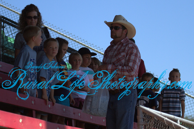 4881<br /> This gentlemen was patiently explaining the rules of Rodeo to his class.
