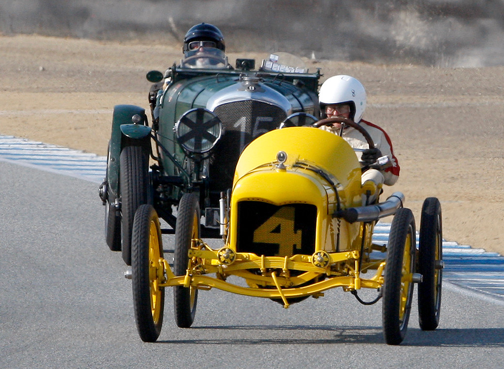 . Ed Archer (4) in his 1915 Ford Roadster leads Bruce McCaw (15) in his 1929 Bentley 4.5 liter LeMans around turn-4 in the Group 1A Pre-1940 Sports Racing and Touring Cars class at Mazda Raceway Laguna Seca in Monterey during the Rolex Monterey Motorsports Reunion on Friday, Aug. 18, 2017.  (Vern Fisher - Monterey Herald)