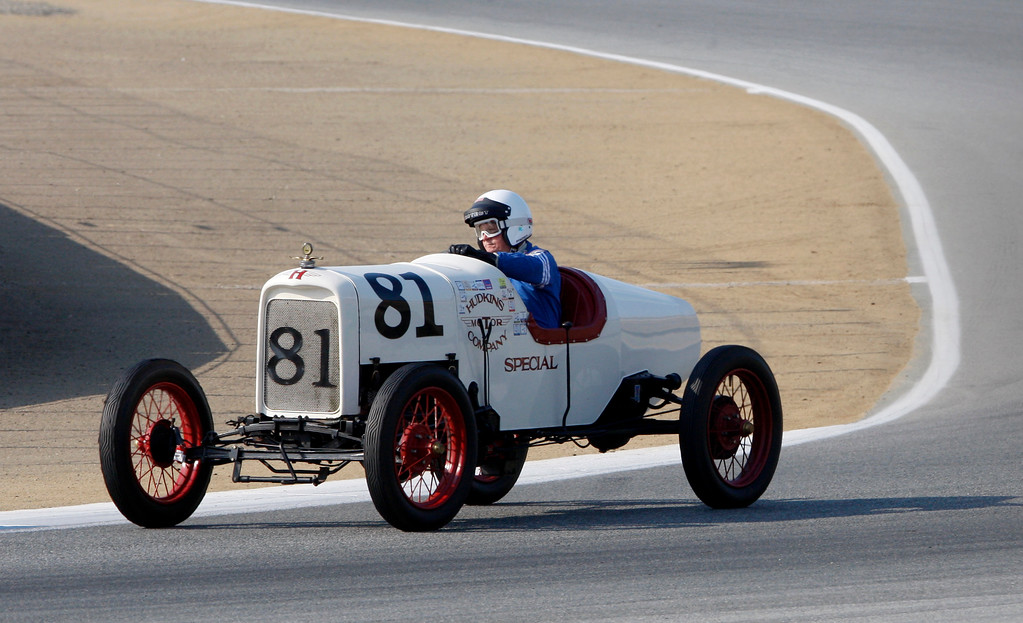 . Bruce Hudkins (81) races his 1922 Ford Model T Speedster around turn-3 in the Group 1A Pre-1940 Sports Racing and Touring Cars class at Mazda Raceway Laguna Seca in Monterey during the Rolex Monterey Motorsports Reunion on Friday, Aug. 18, 2017.  (Vern Fisher - Monterey Herald)
