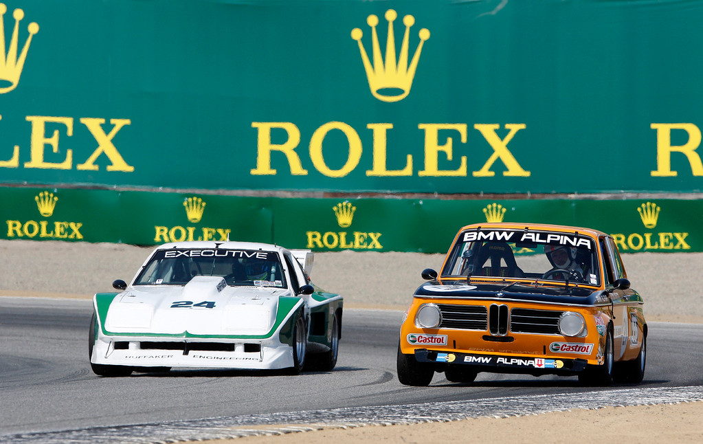 . Kiel Hogan (24) in his 1976 Dekon Monza races against Adrian Van Hooydonk (21) in his 1970 BMW Alpina 2002 ti in the Group 4A 1973-1981 FIA, IMSA, GT, GTX, AAGT class at Mazda Raceway Laguna Seca in Monterey during the Rolex Monterey Motorsports Reunion on Friday, Aug. 18, 2017.  (Vern Fisher - Monterey Herald)