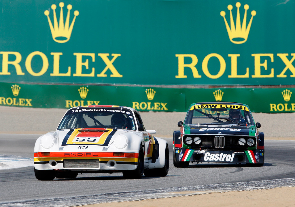. Jeff Lewis (55) in his 1974 Porsche 911 RSR out of turn-3 in the Group 4A 1973-1981 FIA, IMSA, GT, GTX, AAGT class at Mazda Raceway Laguna Seca in Monterey during the Rolex Monterey Motorsports Reunion on Friday, Aug. 18, 2017.  (Vern Fisher - Monterey Herald)