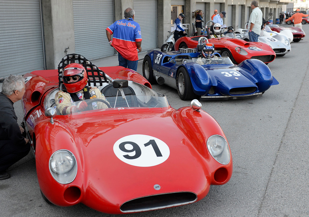 . Racers get ready in the pits in the Group 3A 1955-1961 Sports Racing over 2000cc class at Mazda Raceway Laguna Seca in Monterey during the Rolex Monterey Motorsports Reunion on Friday, Aug. 18, 2017.  (Vern Fisher - Monterey Herald)