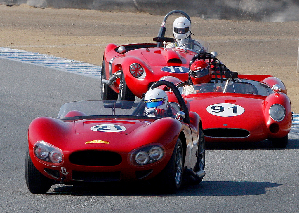 . Mike Fisher (21) in his 1959 Bo Car XP5 leads Fred Burke (91) in his 1962 Cooper MonacoMKII and Gary Cox (11) in his 1953 Healey Chevy Special in the Group 3A 1955-1961 Sports Racing over 2000cc class at Mazda Raceway Laguna Seca in Monterey during the Rolex Monterey Motorsports Reunion on Friday, Aug. 18, 2017.  (Vern Fisher - Monterey Herald)