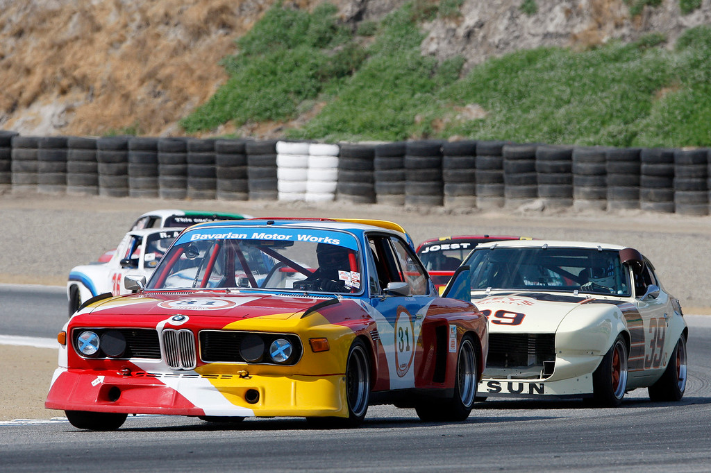 . Dean DeSantis (31) leads a group out of turn-3 in his 1973 BMW CSL in the Group 4A 1973-1981 FIA, IMSA, GT, GTX, AAGT class at Mazda Raceway Laguna Seca in Monterey during the Rolex Monterey Motorsports Reunion on Friday, Aug. 18, 2017.  (Vern Fisher - Monterey Herald)