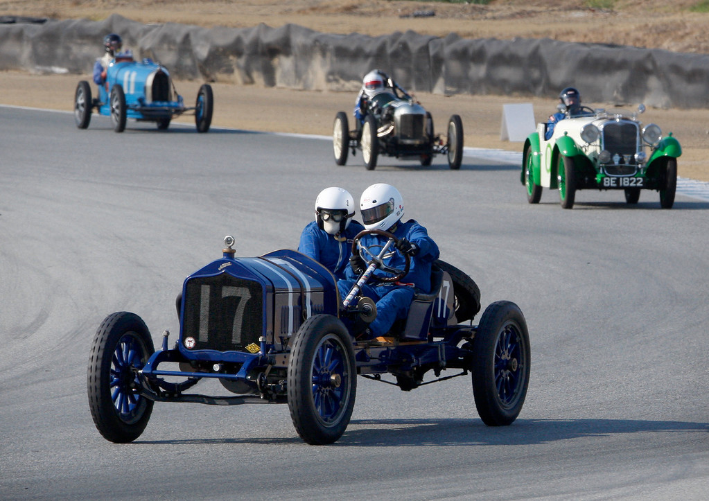 . Jim Putnam (17) leads a group of racers around turn-3 in his 1916 National AC in the Group 1A Pre-1940 Sports Racing and Touring Cars class at Mazda Raceway Laguna Seca in Monterey during the Rolex Monterey Motorsports Reunion on Friday, Aug. 18, 2017.  (Vern Fisher - Monterey Herald)