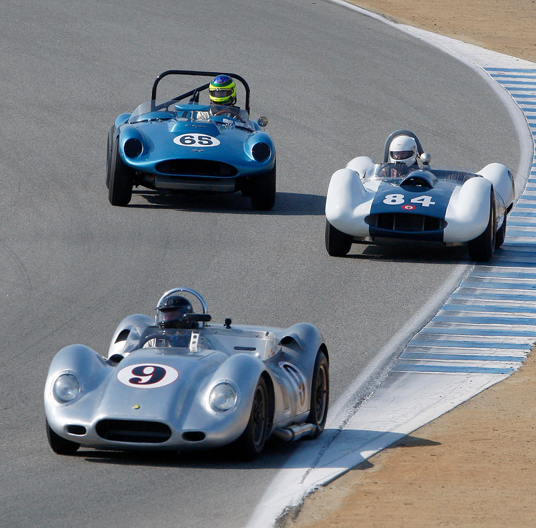 . Al Arciero (9) in his 1958 Lister Knobbly leads Greg Meyer (84) in his 1959 Sadler MKIV and Rick Knoop (65) in his 1959 Echidna Special in the Group 3A 1955-1961 Sports Racing over 2000cc class at Mazda Raceway Laguna Seca in Monterey during the Rolex Monterey Motorsports Reunion on Friday, Aug. 18, 2017.  (Vern Fisher - Monterey Herald)