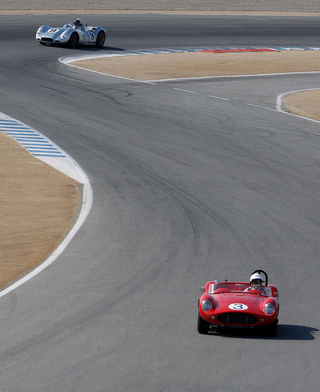 . Nick Colonna (3) in his 1958 Devin SS leads Al Arciero (9) in his 1958 Lister Knobbly in the Group 3A 1955-1961 Sports Racing over 2000cc class at Mazda Raceway Laguna Seca in Monterey during the Rolex Monterey Motorsports Reunion on Friday, Aug. 18, 2017.  (Vern Fisher - Monterey Herald)