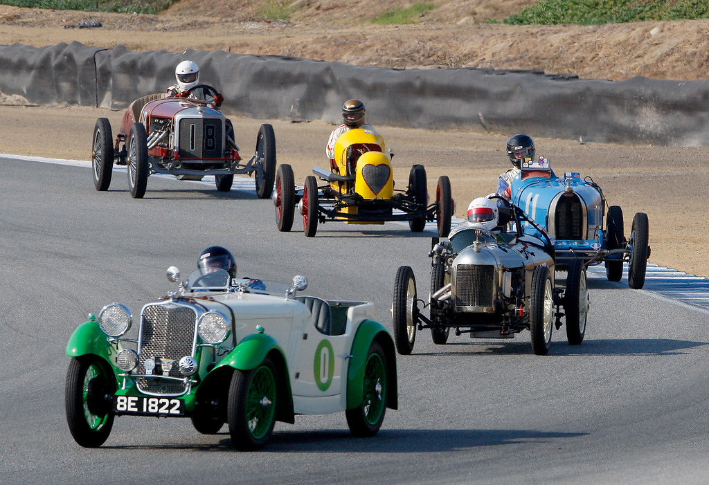 . Ronald Stauber (0) leads a group a racers around turn-3 in his 1933 Singer Nine in the Group 1A Pre-1940 Sports Racing and Touring Cars class at Mazda Raceway Laguna Seca in Monterey during the Rolex Monterey Motorsports Reunion on Friday, Aug. 18, 2017.  (Vern Fisher - Monterey Herald)