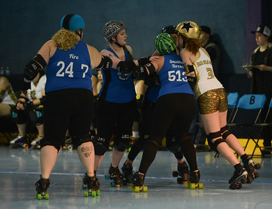 L-R: Nor Cal Roller Girl's Meg Spade aka Fire, Duana Michels aka Crimson Conquers, Emmy Tilson aka Smother Theresa, Carson City Roller's Jennifer Gongaware aka Rue Ella De'vil, Saturday, February 24, 2018, in Chico, California. (Carin Dorghalli -- Enterprise-Record)