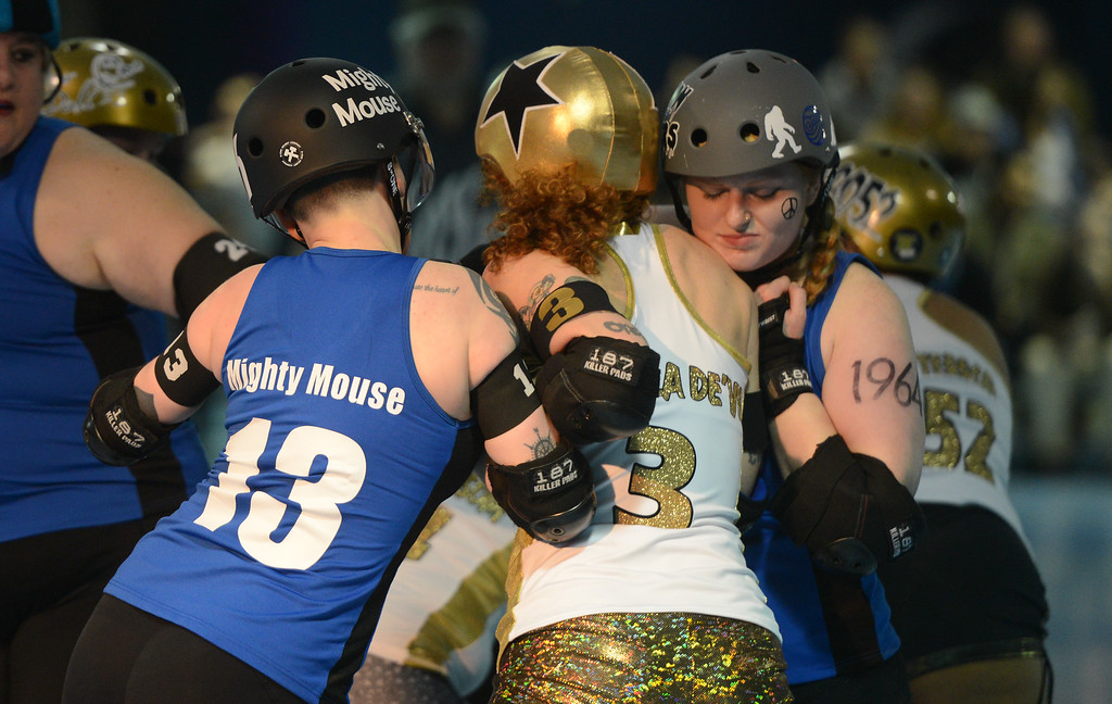 . L-R: Nor Cal Roller Girl\'s Kinsey Abele aka Mighty Mouth,  Carson City Roller\'s Jennifer Gongaware aka Rue Ella De\'vi, Nor Cal Roller Girl\'s Duana Michels aka Crimson Conquers, Saturday, February 24, 2018, in Chico, California. (Carin Dorghalli -- Enterprise-Record)