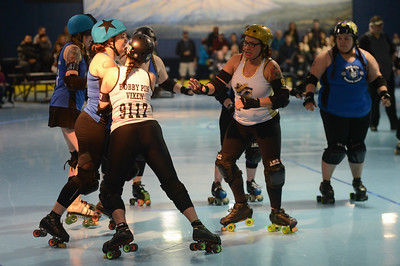 L-R: Nor Cal Roller Girl's Jessica Jarocki aka Tripsy McStumble, Riley Erikson aka Mother Russia, Carson City Roller's Brienna Wilson aka Bobby Pin Vixen, Amy Vidaurri aka Ginger Snap, Nor Cal Roller Girl's Jacque Lewaowicz aka Jac-Kill-N, Saturday, February 24, 2018, in Chico, California. (Carin Dorghalli -- Enterprise-Record)