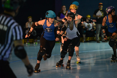 Nor Cal Roller Girl's Jessica Jarocki aka Tripsy McStumble, Carson Victory Roller's Brienna Wilson aka Bobby Pin Vixen, Saturday, February 24, 2018, in Chico, California. (Carin Dorghalli -- Enterprise-Record)