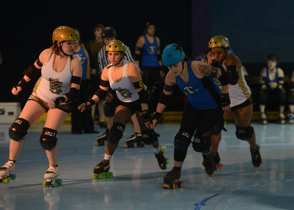 . L-R: Carson City Roller\'s Julia Alty aka Chuck U Norris, Stormi Noll aka Teacup Tempest, Nor Cal Roller Girl\'s Jessica Jarocki aka Tripsy McStumble, Carson City Roller\'s Meredith Taylor aka Shear Terror, Saturday, February 24, 2018, in Chico, California. (Carin Dorghalli -- Enterprise-Record)