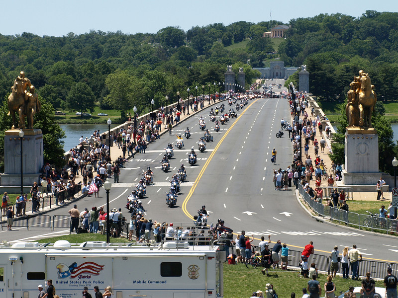 Rolling Thunder Motorcycle Rally, Washington, DC, May 25, 2008. Long line of riders cross Memorial Bridge. Arlingon National Cemetery is in the background.