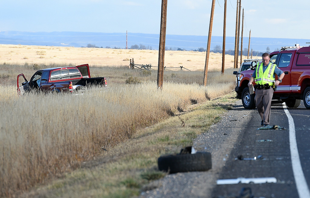. A Colorado State Patrol Trooper investigates a rollover accident Thursday, Oct. 25, 2018, on Wilson Avenue north of 57th Street in north Loveland.  (Photo by Jenny Sparks/Loveland Reporter-Herald)