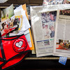 Rolo, a greyhound therapy dog owned by Leominster resident JoAnn Tunnessen, has been diagnosed with osteosarcoma, a bone disease that is fatal for greyhounds. Newspaper clippings, photos and Rolo's work vest sit on a bench at the Tunnessen home. SENTINEL & ENTERPRISE / Ashley Green
