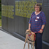 Rolo the rescue greyhound works on his first day as a therapy dog with JoAnn Tunnessen as part of the Pets & People Foundation on Thursday afternoon at a remembrance ceremony at Johnny Ro Veterans Memorial Park in Leominster on Thursday afternoon. SENTINEL & ENTERPRISE / Ashley Green