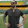 """Former Edmonton Eskimo football player and current World Wrestling Entertainment, Inc. (WWE) superstar Joe """"Roman Reigns"""" Anoai stopped for a visit at Commonwealth Stadium in Edmonton on Thursday August 8, 2019.  (PHOTO BY LARRY WONG/POSTMEDIA)"""