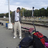 At the train station (the seats had seen better days) - we traveled with two big backpacks and two carry-ons