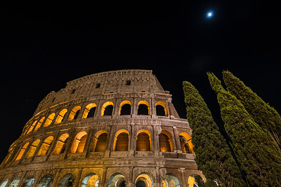 Full moon over the Colosseum in Rome, Italy