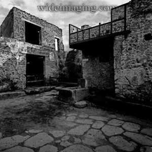 Pompeii, December 2003: Regio I Insula X Vicolo di Paquius Proculus.  Looking east across junction with Vicolo del Menandro, towards I.7.18