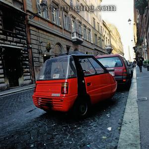 Galassia 50 three wheel micro car on Via Sistina. Obelisk in Piazza della Trinita dei Monti appears in the background. December 27 1993.