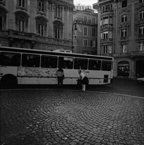Piazza Barberini, from December 26, 1993. In the background right is an elderly gentleman who made a career out of play acting around the piazza dressed in leggings, a tutu, ear muffs, goggles and a feather in his head; seen here hamming it up by a tour bus.