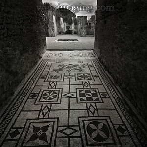 Tiled entrance from Pompeii, December 2003, looks the same as the day it was made.