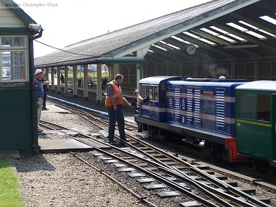 The driver of Captain Howey exchanges token for the section to Romney Sands