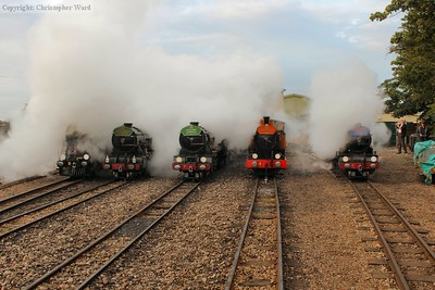 The simultaneous blast of 8 whistles shroud the yard in steam