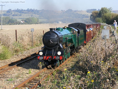 Southern Maid rounds the bend with another train from Hythe