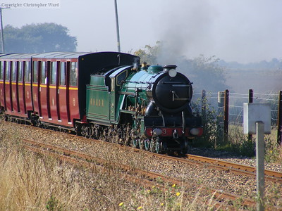 Southern Maid approaches Botolph's Bridge LC with a train non-stop from New Romney