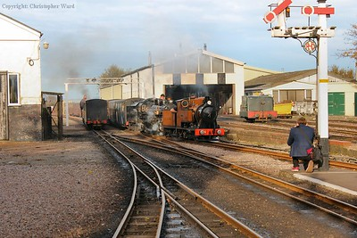 A busy scene as The Bug and Doctor Syn bring the Halloween train into New Romney