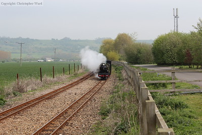 Green Goddess approaches the level crossing at speed
