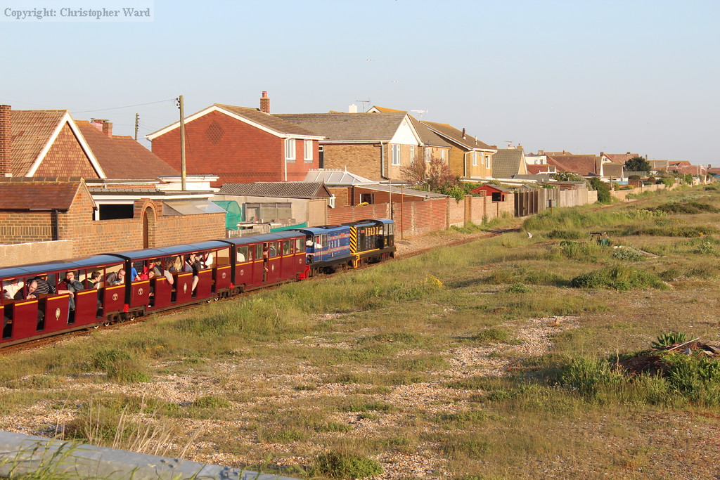 The evening special formed of the diesels and 50 coaches rumbles through