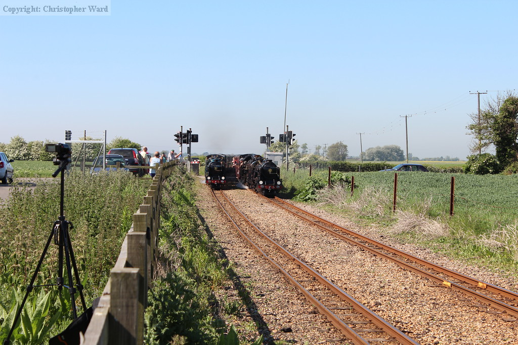Samson and Hurricane run side-by-side through the level crossing