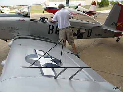 Ron Schreck fiddling with his RV-8 before the Sportsman Class began.