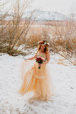 South Lake Tahoe Elopement on a snowy dock overlooking the lake and mountains.
