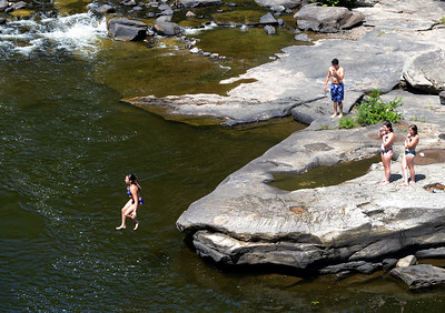 Tania Barricklo-Daily Freeman  Friends enjoy cooling off in the Rondout Creek in High Falls Tuesday afternoon.