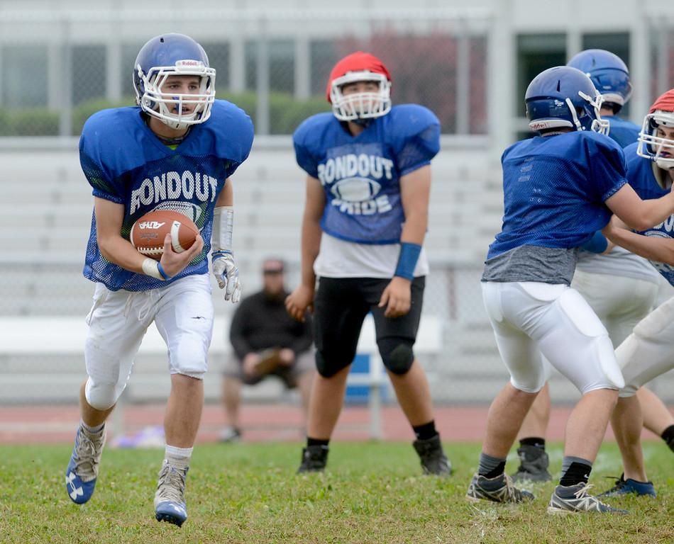 . Tania Barricklo-Daily Freeman  Quarterback Ben Hikade runs the ball