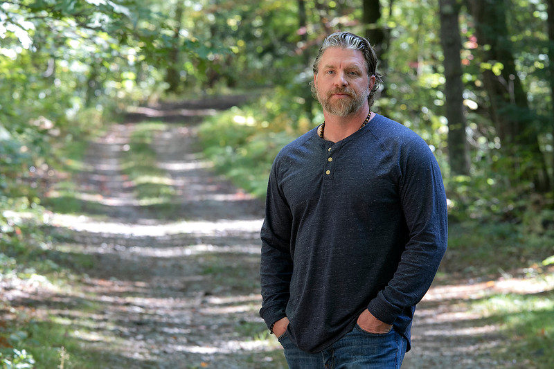 Ronny LeBlanc author of Monsterland takes a walk in the Leominster State Forest , where some of the stories for his books come from, with the Sentinel & Enterprise reporter Monica Busch to talk about his second book, podcast, up coming TV show and his new beer on Friday, September 27, 2019. SENTINEL & ENTERPRISE/JOHN LOVE