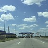 Blue skies and toll roads.