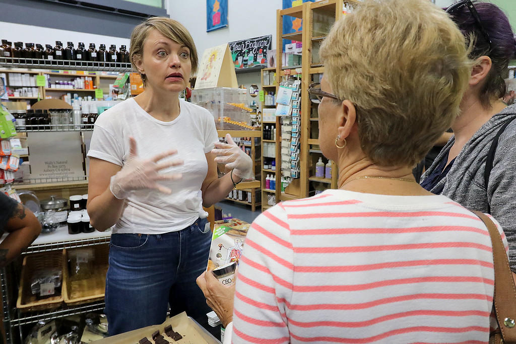 . Roots Market, Kitchen, Juice Bar and Yoga held its Rootsfest 2018 on Saturday, September 8, 2018 in Leominster. Kristin Jorgenson a sales rep for DBD oil out of San Diegio California talks to customers about the oil at the festival. CBD or cannabidiol is a phytocannabinoid found in agricultural hemp. SENTINEL & ENTERPRISE/JOHN LOVE