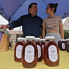 Roots Market, Kitchen, Juice Bar and Yoga held its Rootsfest 2018 on Saturday, September 8, 2018 in Leominster. Michael Fontaine and his daughter Sarah Fontaine of leominster man their booth Wild Brook Apiaries at the festival. they where selling honey made in Leominster. SENTINEL & ENTERPRISE/JOHN LOVE