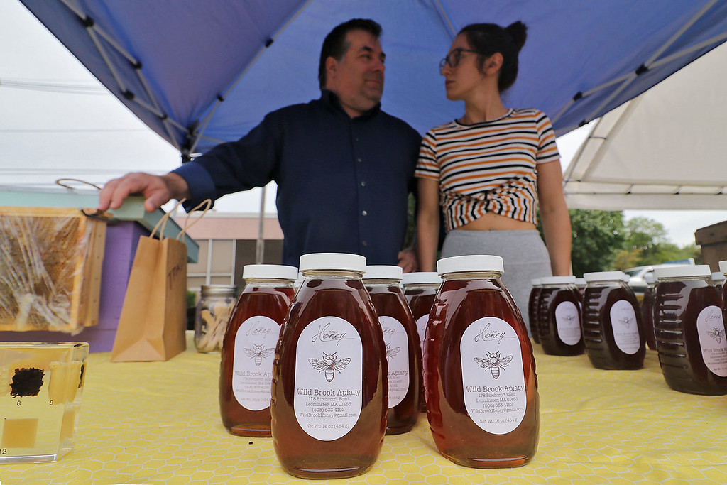 . Roots Market, Kitchen, Juice Bar and Yoga held its Rootsfest 2018 on Saturday, September 8, 2018 in Leominster. Michael Fontaine and his daughter Sarah Fontaine of leominster man their booth Wild Brook Apiaries at the festival. they where selling honey made in Leominster. SENTINEL & ENTERPRISE/JOHN LOVE