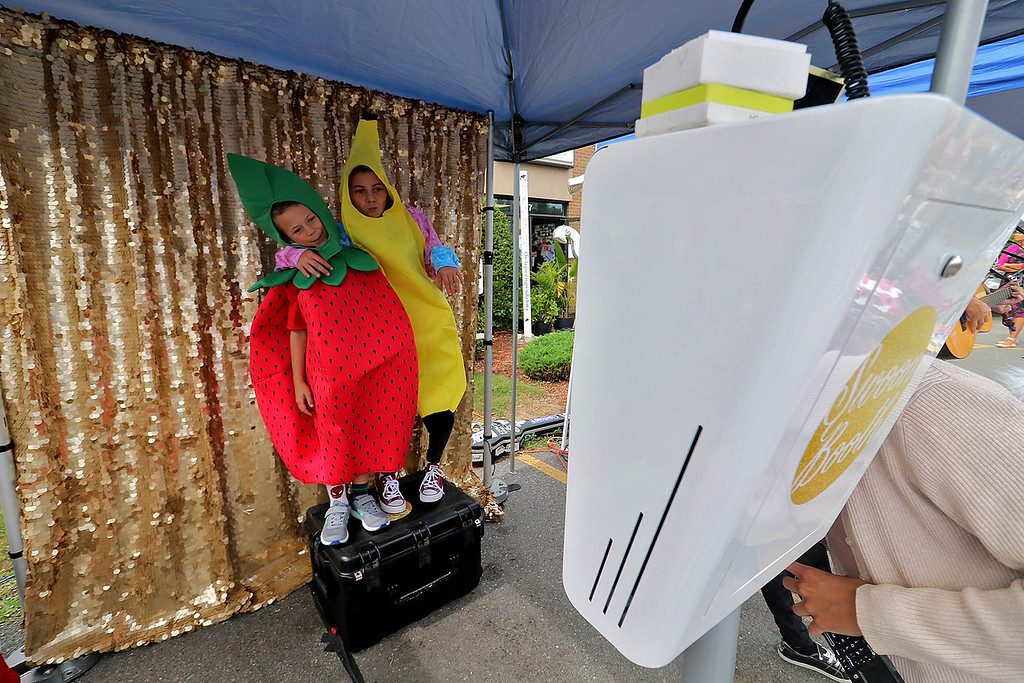 . Roots Market, Kitchen, Juice Bar and Yoga held its Rootsfest 2018 on Saturday, September 8, 2018 in Leominster. Cody Giannoni, 7, and his sister Liliana, 12, dressed up to get their picture taken at a photo booth at the festival. SENTINEL & ENTERPRISE/JOHN LOVE
